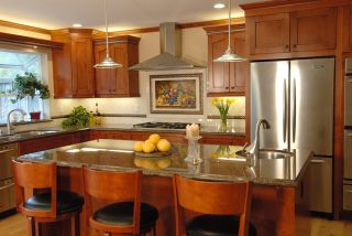 Contemporary stainless and glass pendants - on a dimmer!