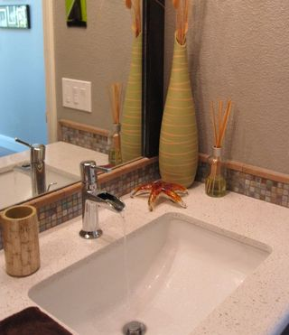 Quartz counter, and interesting lavatory faucets reminiscent of bamboo